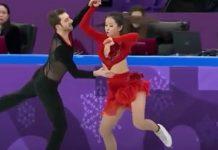 Patinadora olímpica continua prova mesmo depois do fato se ter aberto