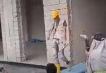 Trabalhadores de obra improvisam desfile de moda no trabalho