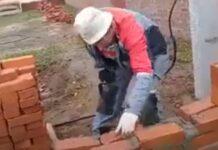 Trabalhador russo constrói muro completamente bêbedo